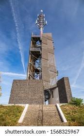 Romanka Lookout Tower is located near village Hruby Jesenik in the district Nymburk in the Central Region. Czech republic. Is is also antenna transmitter. Nice autumn colorful scene with blue sky. - Shutterstock ID 1568325967