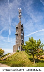 Romanka Lookout Tower is located near village Hruby Jesenik in the district Nymburk in the Central Region. Czech republic. Is is also antenna transmitter. Nice autumn colorful scene with blue sky. - Shutterstock ID 1568662231