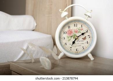 Romantic alarm clock next to the bed