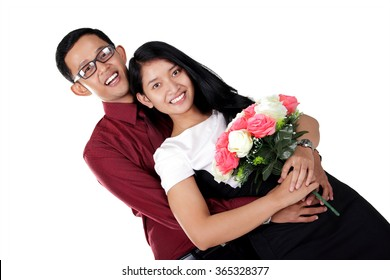 Romantic Asian couple hugging and smile at camera, isolated on white background
