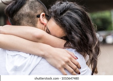 Romantic Asian Couple Meeting/Hugging