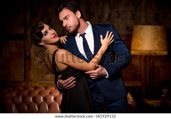 Romantic atmosphere concept. Two luxury man and woman in love. Beautiful elegant lady with red lips in love with millionaires. Wealth, luxury concepts.