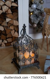 Romantic atmosphere. Warm the house. Cage with candles. Calm