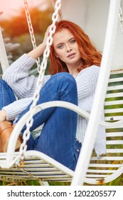 Romantic Autumn Woman Model with Red Hair, with Fall Fashion Girl Outdoors