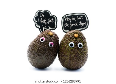 Romantic avocados couple with googly eyes and speech bubble as man and woman, funny food concept for creative projects.