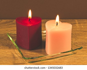 Romantic background with two candles in shape heart