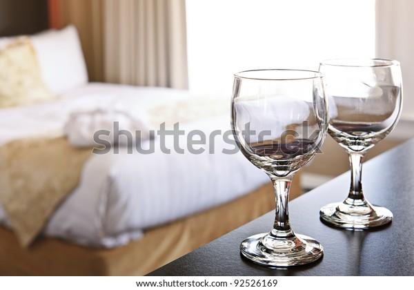 Romantic bedroom with wine glasses in luxury hotel interior