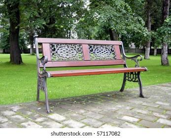 Romantic bench in peacefull park in spring/Bench in Park