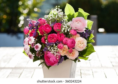 Romantic bouquet with pink roses in the garden