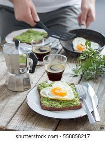 Romantic breakfast â?? avocado and fried egg toast
