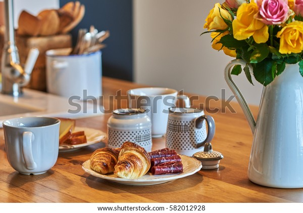 Romantic breakfast on rustic  wooden table and flowers roses.