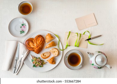 Romantic breakfast on the white table top view