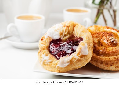 Romantic breakfast setup with Danish pastries and coffee
