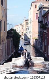 romantic bridal couple on a bridge
