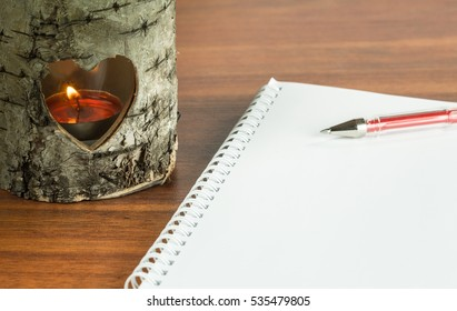 Romantic candle lantern and blank notepad for a love message template