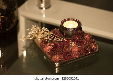 Romantic candle light with fall elements and flowers. Home decoration and inspiration for a romantic night at home.