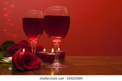 Romantic card a glasses of vine with red roses, hearts  and candles