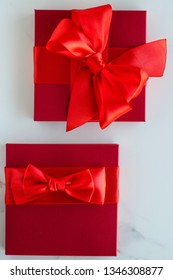 Romantic celebration, lifestyle and birthday present concept - Luxury red holiday gifts on marble