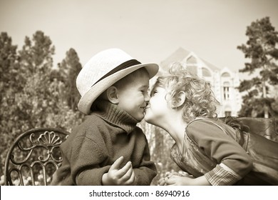 Romantic children at a park. Retro style.