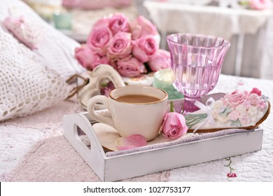 romantic coffee served to bed with bunch of pink roses in shabby chic style interior