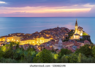 Romantic colorful sunset over picturesque old costal town Piran, Slovenia. Senic panoramic view.