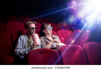Romantic couple cuddling and watching the miraculous part of the film