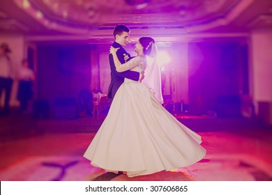 romantic couple dancing on their wedding
