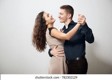 romantic couple dancing tango on white background