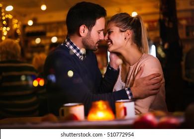 Romantic couple dating at valentines night in pub