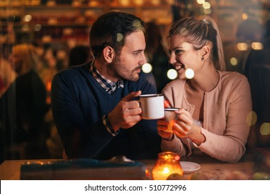 Romantic couple dating at valentines night in pub