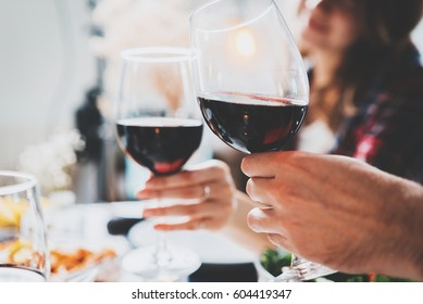 Romantic couple enjoying dinner at home, concept love, relationship and romantic, happy couple celebrating and making cheers with glasses of red wine
