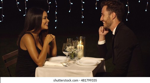 Romantic couple enjoying an evening dinner