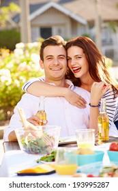 Romantic Couple Enjoying Outdoor Meal In Garden