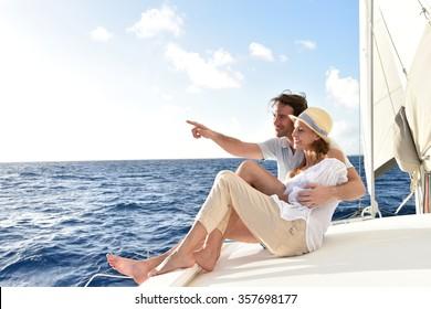 Romantic couple enjoying sail cruise on Caribbean sea