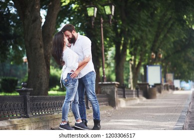 Romantic couple enyojing in moments of happiness in the park. Lifestyle concept love and tenderness.