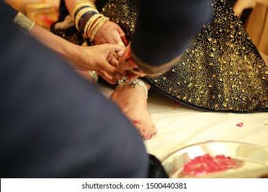Romantic couple exchanging rings during wedding ceremony , handsome groom putting on wedding ring on beautiful bride's hand closeup , Indian Ring Ceremony candid photography