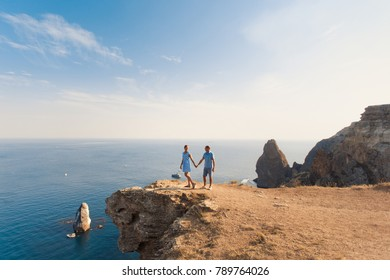 Romantic couple have a date at the top of the mountains with blue ocean view