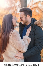 Romantic couple having beautiful moments of happiness and joy in the park. Love and tenderness, dating, romance. Lifestyle concept