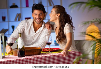 Romantic couple having dinner at home.