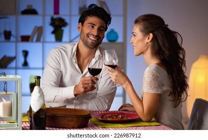 Romantic couple having dinner at home.