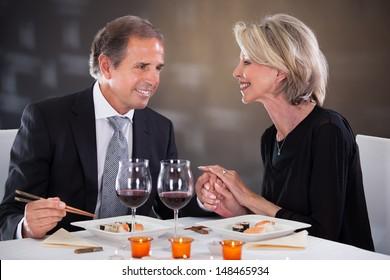 Romantic Couple Having Dinner At The Restaurant