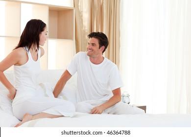 Romantic couple having fun in the bedroom