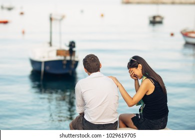 Romantic couple having relationship problems.Woman crying and begging a man.Fisherman life,dangerous occupation.Navy sailors relationship.Dating a sailor.Saying goodbye.Emotional farewell.Break up.