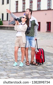 Romantic Couple Having a Trip Around the Town. Making Photograps Together.Vertical Image Composition