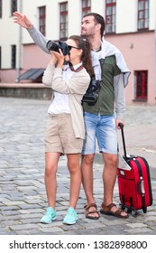 Romantic Couple Having a Trip Around the Town. Making Photograps Together.Vertical Image