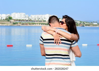 Romantic couple hugging  at the beach.Sea background