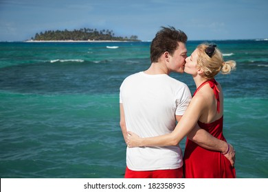 Romantic Couple Kissing at The Sean with Desert Island in Background