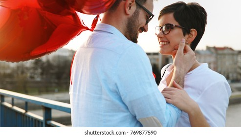 Romantic couple in love dating in sunset outdoor