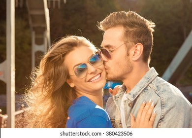Romantic couple in love on the bridge with glasses
