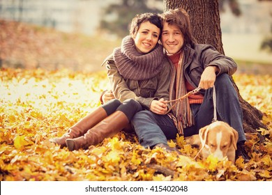 romantic couple in love at the park in autumn